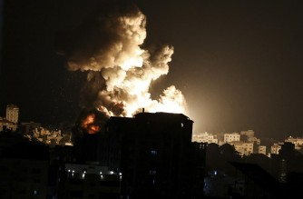 Fire billows from Israeli air strikes in the Gaza Strip, controlled by the Palestinian Islamist movement Hamas, on May 13, 2021. - Around 1,500 rockets have been fired from Gaza into Israeli cities since hostilities escalated between Hamas militants and Israel earlier in the week, Israel's army said on Thursday. The Israeli Defence Force had said early Wednesday that 1,000 rockets had been launched from Gaza since Monday evening, but by early Thursday the number had leapt by roughly 500. (Photo by MAHMUD HAMS / AFP)