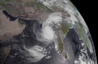 "This National Oceanic and Atmospheric Administration (NOAA) satellite image taken May 17, 2021 at 04:00UTC shows Cyclone Tauktae on the path to reach Gujarat, India. - Cyclone Tauktae -- India's first major tropical storm this season -- is moving northwards in parallel with the country's western coast, bringing heavy rains, thunderstorms and strong winds to several states, the meteorological department said. (Photo by Handout / NASA/NOAA / AFP) / RESTRICTED TO EDITORIAL USE - MANDATORY CREDIT ""AFP PHOTO / NOAA/CIRA/RAMMB / HANDOUT "" - NO MARKETING - NO ADVERTISING CAMPAIGNS - DISTRIBUTED AS A SERVICE TO CLIENTS"