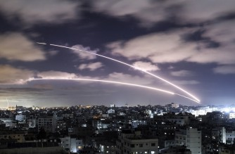 Rockets are launched towards Israel from Gaza City, controlled by the Palestinian Hamas movement, on May 18, 2021, amid a flare-up of Israeli-Palestinian violence. (Photo by MAHMUD HAMS / AFP)