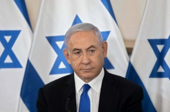 """Israeli Prime Minister Benjamin Netanyahu gestures as he shows a slideshow during a briefing to ambassadors to Israel at the Hakirya military base in Tel Aviv, Israel on May 19, 2021. - Prime Minister Benjamin Netanyahu said today that Israel's aerial bombing campaign on the Gaza Strip was aimed at deterring Hamas, but did not rule out conquering the enclave's Islamist rulers. """"There are only two ways that you can deal with them (Hamas): You can either conquer them, and that's always an open possibility, or you can deter them, and we are engaged right now in forceful deterrence, but I have to say we don't rule out anything,"""" Netanyahu told a group a foreign ambassadors in Tel Aviv. (Photo by Sebastian Scheiner / POOL / AFP)"""