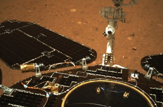 This picture released on May 19, 2021, by the China National Space Administration (CNSA) via CNS shows an image taken by the navigation camera of China's Zhurong rover on the surface of Mars, showing the rover's solar panels and antenna, after it landed on Mars on May 15, 2021. (Photo by - / CNS/CNSA / AFP) / China OUT