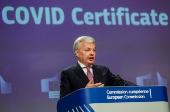European Commissioner for Justice Didier Reynders gives a press conference on the EU digital Covid-19 Certificate at the European Commission in Brussels, on May 21, 2021. - EU member states reached a deal on May 20, 2021, paving the way for a Covid-19 certificate to open up travel in Europe. (Photo by STEPHANIE LECOCQ / POOL / AFP)