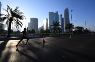 Competitors run during the ADNOC Abu Dhabi marathon on December 7, 2018 in the United Arab Emirates. (Photo by GIUSEPPE CACACE / AFP)