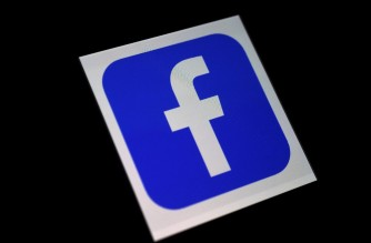 In this photo illustration a Facebook App logo is displayed on a smartphone on March 25, 2020 in Arlington, Virginia. (Photo by Olivier DOULIERY / AFP)