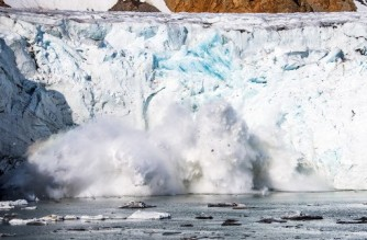 (FILES) This file photo taken on August 17, 2019 shows an iceberg calving with a mass of ice breaking away from the Apusiajik glacier, near Kulusuk (aslo spelled Qulusuk), a settlement in the Sermersooq municipality located on the island of the same name on the southeastern shore of Greenland. - The Arctic has warmed three times more quickly than the planet as a whole, and faster than previously thought, a report warned on May 20, 2021. (Photo by Jonathan NACKSTRAND / AFP)