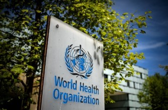 (FILES) This file photo taken on May 8, 2021, shows a sign of the World Health Organization (WHO) at the entrance of their headquarters in Geneva amid the Covid-19 coronavirus outbreak. - Fifty-three countries voiced alarm on May 28, 2021, at reports that World Health Organization leaders knew of sexual abuse allegations against the UN agency's staff and sat on them. (Photo by Fabrice COFFRINI / AFP)