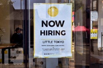 A 'Now Hiring' sign is posted in front of an ice-cream shop in Los Angeles, California on May 28, 2021. - Following over a year of restrictions due to the coronavirus pandemic, many jobs at restaurants, retail stores and bars remain unfilled, despite California's high unemployment rate, causing some owners to fear they will not be able to fully reopen by the June 15th date California has given for a full reopening of the economy. (Photo by Frederic J. BROWN / AFP)