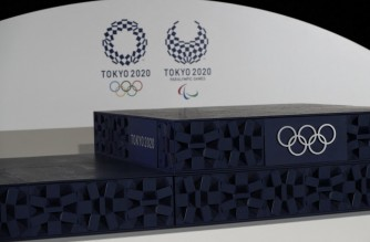 The podium to be used for the medal ceremonies at the Tokyo 2020 Olympics Games is seen during an event to mark 50 days to the opening ceremony, at Ariake Arena in Tokyo on June 3, 2021. (Photo by ISSEI KATO / POOL / AFP)