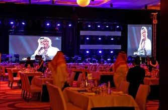 """A picture taken late on June 3, 2021 show a theatre hosting the first concert in the Saudi capital Riyadh since the start of the COVID-19 pandemic. - Riyadh is accelerating a nationwide vaccination drive as it moves to revive tourism and host sports and entertainment extravaganzas, all pandemic-hit sectors that are a bedrock of the """"Vision 2030"""" program to diversify the oil-reliant economy. (Photo by Fayez Nureldine / AFP)"""