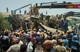 Security personnel carry out rescue operation at the site of a train accident in Daharki area of the northern Sindh province on June 7, 2021, as at least 34 people were killed and dozens injured when a packed Pakistani inter-city train ploughed into another express that had derailed earlier, officials said. (Photo by Shahid ALI / AFP)