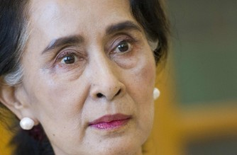 (FILES) In this file photo taken on August 25, 2015, chairperson of National League for Democracy (NLD) Aung San Suu Kyi listens during an interview at the parliament in Naypyidaw. - Myanmar's deposed leader Aung San Suu Kyi has been hit with fresh corruption charges, state-run media reported on June 10, 2021. (Photo by STR / AFP)