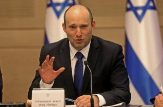 Israel's incoming Prime Minister Naftali Bennett gives an address before the new cabinet at the Knesset in Jerusalem on June 13, 2021. - Featuring Israeli political veterans and a record number of female lawmakers, a motley coalition including two left, two centre, one Arab Islamist and three right-wing parties came to power Sundayin an eight-party alliance united by animosity for outgoing prime minister Benjamin Netanyahu. (Photo by Gil COHEN-MAGEN / AFP)