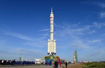(FILES) This file photo taken on June 9, 2021 shows a Long March-2F carrier rocket carrying the Shenzhou-12 spacecraft for China's first manned mission to its new space station,  scheduled for June 17, at the Jiuquan Satellite Launch Centre in the country's northwestern Gansu province. - The first crew for China's new space station prepared to blast off on June 17, 2021 for the latest step in Beijing's ambitious programme to establish itself as a space power. (Photo by STR / China News Service (CNS) / AFP) / China OUT / TO GO WITH China-space,ADVANCER by Ludovic Ehret and Poornima Weerasekara