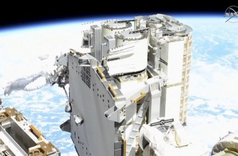 """This NASA TV frame grab image captured on June 16, 2021 shows US astronaut Shane Kimbrough(L), checking the solar arrays during the ISS Expedition 65 US Spacewalk # 74 to install the First IROSA Solar Array on the P6 Truss for the 2B Channel Power System. - The spacewalk will last over six hours in support of station assembly, maintenance, and upgrades. (Photo by Lizabeth MENZIES / NASA TV / AFP) / RESTRICTED TO EDITORIAL USE - MANDATORY CREDIT """"AFP PHOTO /NASA TV/HANDOUT """" - NO MARKETING - NO ADVERTISING CAMPAIGNS - DISTRIBUTED AS A SERVICE TO CLIENTS"""