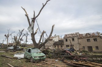 Destroyed trees and debris of damaged buildings are seen on June 25, 2021 in the village of Mikulcice, 60 km south of Brno, South Moravia, Czech Republic, after it was hit by a tornado. - At least three people died and dozens were injured after a rare tornado razed houses to the ground in the Czech Republic's southeast, rescuers said on June 25. (Photo by Michal Cizek / AFP)