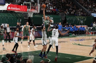 MILWAUKEE, WI - JUNE 10: Giannis Antetokounmpo #34 of the Milwaukee Bucks dunks the ball against the Brooklyn Nets during Round 2, Game 3 of the 2021 NBA Playoffs on June 10, 2021 at the Fiserv Forum Center in Milwaukee, Wisconsin. NOTE TO USER: User expressly acknowledges and agrees that, by downloading and or using this Photograph, user is consenting to the terms and conditions of the Getty Images License Agreement. Mandatory Copyright Notice: Copyright 2021 NBAE   Nathaniel S. Butler/NBAE via Getty Images/AFP. (Photo by Nathaniel S. Butler / NBAE / Getty Images / Getty Images via AFP)