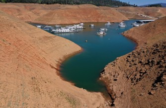 OROVILLE, CALIFORNIA - JUNE 01: Low water levels are visible next to houseboats that sit anchored at the Bidwell Canyon Marina on Lake Oroville on June 01, 2021 in Oroville, California. As water levels continue to fall at Lake Oroville, officials are flagging houseboats that are anchored on the lake for removal to avoid being stuck or damaged. Lake Oroville is currently at 38 percent of normal capacity. According to the U.S. Drought Monitor, 16 percent of California is in exceptional drought, the most severe level of dryness.   Justin Sullivan/Getty Images/AFP (Photo by JUSTIN SULLIVAN / GETTY IMAGES NORTH AMERICA / Getty Images via AFP)