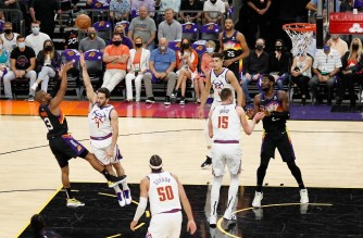 PHOENIX, ARIZONA - JUNE 09: Chris Paul #3 of the Phoenix Suns puts up a shot over Facundo Campazzo #7 of the Denver Nuggets during the first half in Game Two of the Western Conference second-round playoff series at Phoenix Suns Arena on June 09, 2021 in Phoenix, Arizona. The Suns defeated the Nuggets 123-98. NOTE TO USER: User expressly acknowledges and agrees that, by downloading and or using this photograph, User is consenting to the terms and conditions of the Getty Images License Agreement.   Christian Petersen/Getty Images/AFP (Photo by Christian Petersen / GETTY IMAGES NORTH AMERICA / Getty Images via AFP)