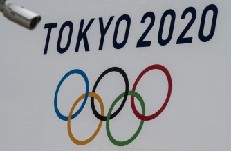 A Tokyo 2020 Olympics Games banner is displayed on the wall of the Tokyo Metropolitan Government building in Tokyo on April 13, 2021. (Photo by Charly TRIBALLEAU / AFP)