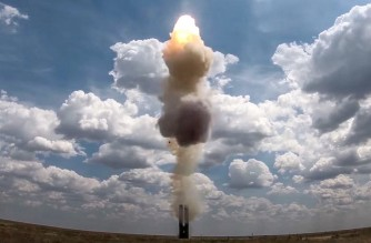 """This handout photograph released by the Russian Defence Ministry on July 20, 2021, shows the latest S-500 air defense missile weapon system as it carries out live fire exercises to hit a high-speed ballistic target at The Kapustin Yar Training Ground in Russia. - Moscow said that it had successfully test-fired its new S-500 air defence missile systems at a training ground in southern Russia and hit a high-speed ballistic target. (Photo by Handout / Russian Defence Ministry / AFP) / RESTRICTED TO EDITORIAL USE - MANDATORY CREDIT """"AFP PHOTO / RUSSIAN DEFENCE MINISTRY"""" - NO MARKETING - NO ADVERTISING CAMPAIGNS - DISTRIBUTED AS A SERVICE TO CLIENTS"""