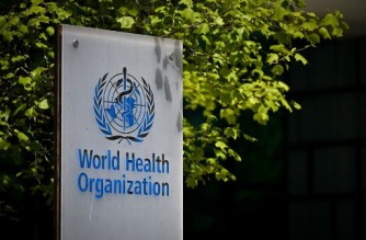 A picture taken on May 8, 2021 shows a sign of the World Health Organization (WHO) at the entrance of their headquarters in Geneva amid the Covid-19 coronavirus outbreak. - . (Photo by Fabrice COFFRINI / AFP)