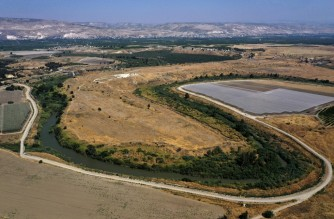An aerial picture taken on July 15, 2021, shows a section of the Jordan river flowing along the border with Jordan (background), south of the Sea of Galilee, or Lake Tiberias, one of the main water sources in Israel. - As scientific warnings of dire climate change-induced drought grow, many in Israel and Jordan cast worried eyes at the river running between them and the critical but limited resources they share. (Photo by MENAHEM KAHANA / AFP)