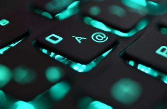 """FILES) This file photo illustration picture taken on June 25, 2019 in Brest shows a close-up view of a computer keyboard. - A firm specializing in transferring cryptocurrency said on August 12, 2021 that a hacker they are calling """"Mr White Hat"""" was giving back all $613 million in digital loot from a record haul. Poly Network had put out word previously that nearly half of the digital assets swiped early this week had been returned. (Photo by Fred TANNEAU / AFP)"""