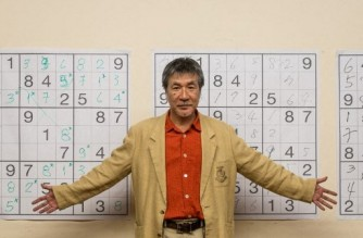 """(FILES) In this file photo taken on September 29, 2012, Japanese puzzle manufacturer Maki Kaji poses for a picture during the first Sudoku national competition in Sao Paulo. - The man dubbed the """"father of Sudoku"""" for his role in popularising the numerical brainteaser loved by millions, has died of cancer at 69, his Japanese publisher has announced. In a notice posted August 16, 2021, Nikoli said Maki Kaji died at home on August 10 after battling cancer, and a memorial service would be held at a later date. (Photo by Yasuyoshi CHIBA / AFP)"""