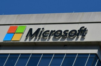 (FILES) In this file photo taken on May 20, 2021 a Microsoft logo adorns a building in Chevy Chase, Maryland. - Some 38 million records stored on a Microsoft service, including private information, were mistakenly left exposed this year, security firm UpGuard said on August 23, 2021. The data, including names, addresses, financial information and Covid-19 vaccination statuses, was made vulnerable -- but not compromised -- before the problem was resolved, according to the digital security company's investigation. (Photo by Eva HAMBACH / AFP)