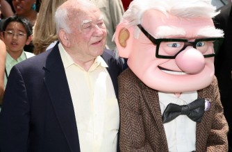 """(FILES) In this file photo actor Ed Asner and character Carl Fredricksen arrive for the premiere of Disney Pixar's """"Up"""" at the El Capitan Theatre in Hollywood on May 16, 2009. - Ed Asner, the prolific US character actor who became a star in middle age as the gruff but lovable newsman Lou Grant, first in the hit TV comedy """"The Mary Tyler Moore Show"""" and later in the drama """"Lou Grant,"""" died on August 29, 2021. He was 91. (Photo by Valerie MACON / AFP)"""