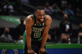 BOSTON, MA - MAY 28: Kemba Walker #8 of the Boston Celtics smiles during the game against the Brooklyn Nets during Round 1, Game 3 of the 2021 NBA Playoffs on May 28, 2021 at the TD Garden in Boston, Massachusetts. NOTE TO USER: User expressly acknowledges and agrees that, by downloading and or using this photograph, User is consenting to the terms and conditions of the Getty Images License Agreement. Mandatory Copyright Notice: Copyright 2021 NBAE   Brian Babineau/NBAE via Getty Images/AFP (Photo by Brian Babineau / NBAE / Getty Images / Getty Images via AFP)