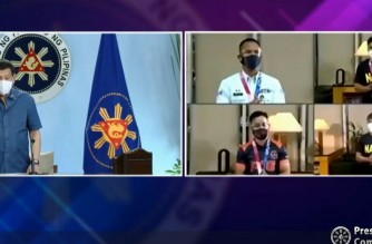 President Rodrigo Duterte salutes the Filipino boxers who represented the country in the recently concluded Tokyo Olympics. (Screenshot of PCOO video/Aug. 9, 2021)