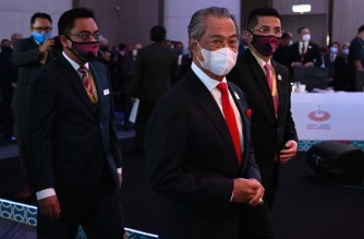 Malaysia's Prime Minister Muhyiddin Yassin (2nd R) arrives for the virtual meeting at the online Asia-Pacific Economic Cooperation (APEC) leaders' summit in Kuala Lumpur on November 20, 2020. (Photo by MOHD RASFAN / AFP)