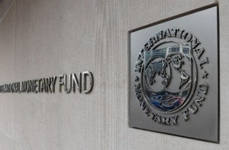 An exterior view of the building of the International Monetary Fund (IMF), with the IMG logo, is seen on March 27, 2020 in Washington, DC. - The coronavirus pandemic has driven the global economy into a downturn that will require massive funding to help developing nations, IMF chief Kristalina Georgieva said on March 27, 2020. (Photo by Olivier DOULIERY / AFP)