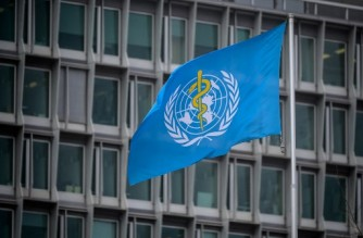 This photograph taken on March 5, 2021 shows the flag of the World Health Organization (WHO) at their headquarters in Geneva amid the Covid-19 coronavirus outbreak. (Photo by Fabrice COFFRINI / AFP)