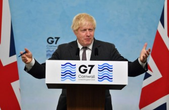 Britain's Prime Minister Boris Johnson takes part in a press conference on the final day of the G7 summit in Carbis Bay, Cornwall on June 13, 2021. (Photo by Ben STANSALL / various sources / AFP)