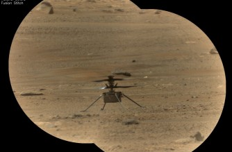 """This NASA photo obtained June 13, 2021, 2021 shows NASA's Ingenuity Mars Helicopter(C) viewed through the Remote Microscopic Imager (RMI) camera, part of the SuperCam instrument aboard NASA's Perseverance rover,taken on May 14, 2021, the 82nd Martian day, or sol, of the mission. - The RMI is able to spot a softball from nearly a mile away, allowing scientists to take images of details from a long distance. It also provides fine details of nearby targets zapped by SuperCam's laser. (Photo by Handout / various sources / AFP) / RESTRICTED TO EDITORIAL USE - MANDATORY CREDIT """"AFP PHOTO / NASA/JPL-Caltech/LANL/CNES/CNRS/HANDOUT"""" - NO MARKETING - NO ADVERTISING CAMPAIGNS - DISTRIBUTED AS A SERVICE TO CLIENTS"""