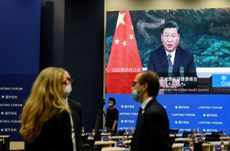 A screen shows video footage of Chinese President Xi Jinping ahead of the Lanting Forum in Beijing on June 25, 2021. (Photo by Jade GAO / AFP)