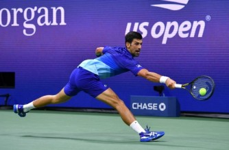 Serbia's Novak Djokovic hits a return to US player Jenson Brooksby during their 2021 US Open Tennis tournament men's singles fourth round match at the USTA Billie Jean King National Tennis Center in New York, on September 6, 2021. (Photo by Ed JONES / AFP)