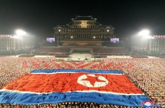 """This picture taken on September 9, 2021 and released from North Korea's official Korean Central News Agency (KCNA) shows a parade of 'paramilitary and public security forces' to celebrate the 73rd founding anniversary of North Korea at Kim Il Sung Square in Pyongyang. (Photo by STR / KCNA VIA KNS / AFP) / South Korea OUT / ---EDITORS NOTE--- RESTRICTED TO EDITORIAL USE - MANDATORY CREDIT """"AFP PHOTO/KCNA VIA KNS"""" - NO MARKETING NO ADVERTISING CAMPAIGNS - DISTRIBUTED AS A SERVICE TO CLIENTS / THIS PICTURE WAS MADE AVAILABLE BY A THIRD PARTY. AFP CAN NOT INDEPENDENTLY VERIFY THE AUTHENTICITY, LOCATION, DATE AND CONTENT OF THIS IMAGE --- /"""