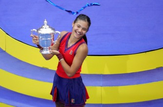 Britain's Emma Raducanu celebrates with the trophy after winning the 2021 US Open Tennis tournament women's final match against Canada's Leylah Fernandez at the USTA Billie Jean King National Tennis Center in New York, on September 11, 2021. (Photo by Kena Betancur / AFP)