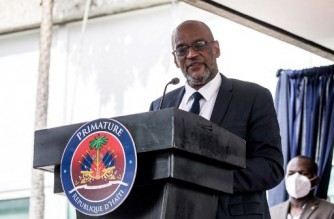 (FILES) In this file photo Designated Prime Minister Ariel Henry speaks during a ceremony at La Primature in Port-au-Prince, Haiti, on July 20, 2021. - Haiti's top prosecutor said on September 14, 2021 he was seeking charges against Prime Minister Ariel Henry for the July assassination of President Jovenel Moise. The Port-au-Prince government commissioner, the equivalent of a federal prosecutor, asked the judge investigating the killing to charge Henry with involvement in the case over alleged phone calls Henry made with one of the main suspects. (Photo by Valerie Baeriswyl / AFP)