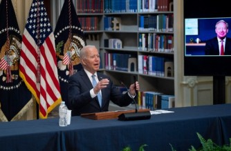 The President of Microsoft Brad Smith is seen on a screen as US President Joe Biden hosts a meeting with business leaders and CEOs on the Covid-19 response, at the Eisenhower Executive Office Building in Washington, DC, on September 15, 2021. (Photo by Brendan Smialowski / AFP)