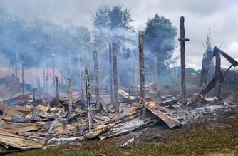 """This handout taken on September 10, 2021 and received courtesy of an anonymous source on September 18 shows the remains of burnt houses in Namg Kar village in Magwe region's Gangaw township, as fighting continues between the Myanmar military and protesters against the military coup. (Photo by Handout / ANONYMOUS / AFP) / -----EDITORS NOTE --- RESTRICTED TO EDITORIAL USE - MANDATORY CREDIT """"AFP PHOTO / ANONYMOUS SOURCE """" - NO MARKETING - NO ADVERTISING CAMPAIGNS - DISTRIBUTED AS A SERVICE TO CLIENTS"""
