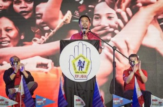 """This handout photo taken on September 19, 2021, courtesy of the office of Philippine Senator Koko Pimentel shows Philippine boxer-turned-politician Manny Pacquiao (C) speaking during the PDP-Laban national assembly in Manila. (Photo by - / Office of Philippine Senator Koko Pimentel / AFP) / -----EDITORS NOTE --- RESTRICTED TO EDITORIAL USE - MANDATORY CREDIT """"AFP PHOTO / OFFICE OF SENATOR KOKO PIMENTEL """" - NO MARKETING - NO ADVERTISING CAMPAIGNS - DISTRIBUTED AS A SERVICE TO CLIENTS"""