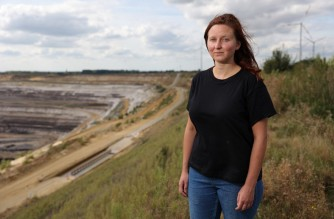 Kathrin Henneberger, a candidate for the Greens in the German parliamentary elections and former spokeswomen for anti-coal activist group Ende Gelaende, is pictured near the Garzweiler coal mine in western Germany on September 19, 2021. - Dressed in a rainbow-coloured unicorn costume, Kathrin Henneberger once camped on a beech tree, trying to save a forest from destruction. Come Monday, she hopes to be one of Germany's newly elected MPs. (Photo by Yann Schreiber / AFP)