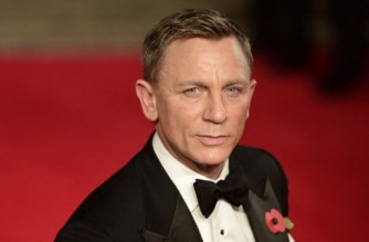 """(FILES) In this file photo taken on October 26, 2015 British actor Daniel Craig arrives for the world premiere of the new James Bond film 'Spectre' at the Royal Albert Hall in London. - After 15 years playing the legendary British spy James Bond, Daniel Craig is making way for a new generation of actors after his fifth film, """"No Time To Die"""", which has its world premiere in London on Tuesday. (Photo by Leon NEAL / AFP)"""