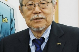 """This picture taken on March 22, 2017 shows Takao Saito, Japanese manga artist whose work includes """"Golgo 13,"""" one of longest-running comic series, has died of pancreatic cancer at the age of 84, a publisher said on September 29, 2021. (Photo by STR / JIJI PRESS / AFP) / Japan OUT"""