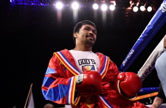 (FILES) This file photo taken on August 21, 2021 shows Manny Pacquiao of the Philippines entering the ring for his fight against Yordenis Ugas of Cuba during the WBA Welterweight Championship boxing match at T-Mobile Arena in Las Vegas, Nevada. - Philippine boxing legend and 2022 presidential hopeful Manny Pacquiao said on September 29, 2021 that he is hanging up his gloves after a glittering decades-long career in the ring. (Photo by Patrick T. FALLON / AFP)