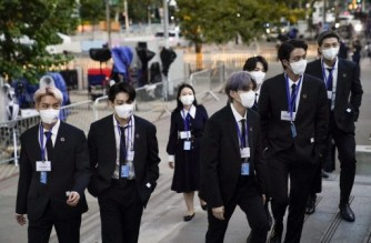 NEW YORK, NEW YORK - SEPTEMBER 20: Members of the South Korean band BTS arrive at United Nations headquarters during the 76th Session of the U.N. General Assembly on September 20, 2021 in New York City. U.S. President Joe Biden will travel to New York today and address the U.N. tomorrow.   John Minchillo-Pool/Getty Images/AFP (Photo by POOL / GETTY IMAGES NORTH AMERICA / Getty Images via AFP)